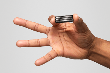 Hand with fingers outstretched showing razor blade, ready for shaving