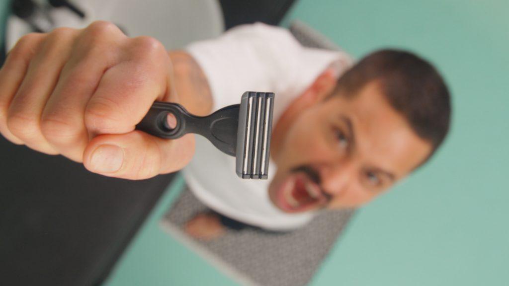 Happy shaver holding up the Boldking razor – The Boldking Shaving Guide