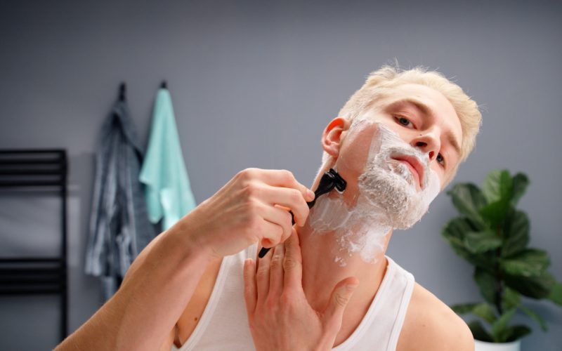 Handsome man shaving – How to shave your face
