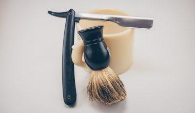 Old fashioned razor and badger brush