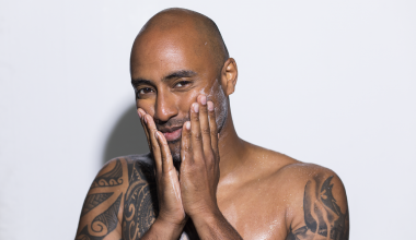 Bald man taking care of his balding head.