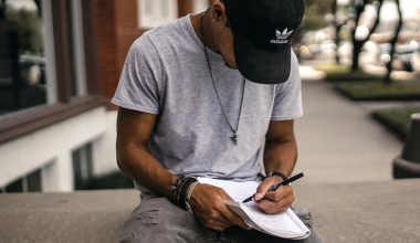Man journaling outside