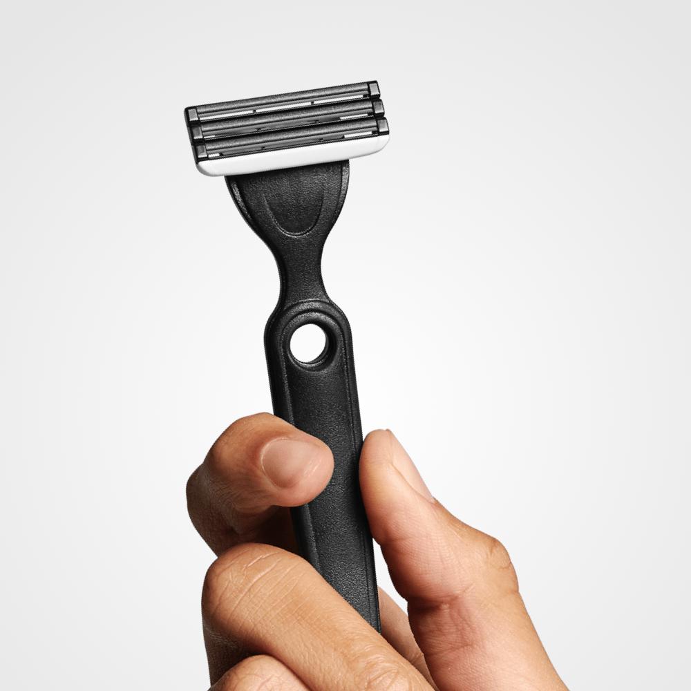 Hand holding the Boldking razor for really sensitive skin –  Boldking